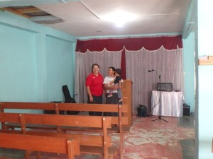 Sandra, director of Neuvo Carazon and Lourdes are happy with the new church.