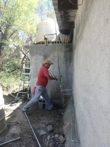 Martin installed a new water system at Pastor Rey's new house.