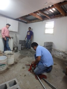 Installing new plumbing in church dinning area.