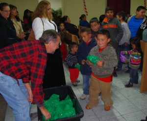 Larry Bookman from Bandera, Texas helped hand out the gifts.