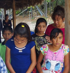 Belinda helped to pray with the children.