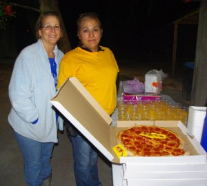 Tonyia and Ana helped prepare and hand out the food.