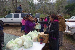 Sandra brought food bags for each family. She operates the Nuevo Corazon food ministry.
