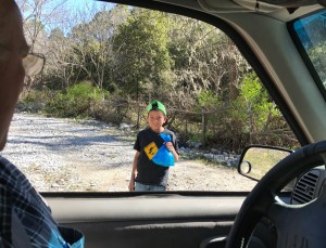 We gave a gift to this boy and his friend. We saw them beside a creek on our way out.