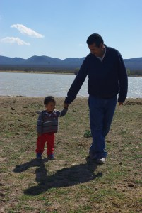 Pastor Rey and son walked beside the lake.