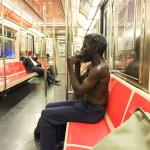 City of Filth: Subway rider smokes crack and strips naked
