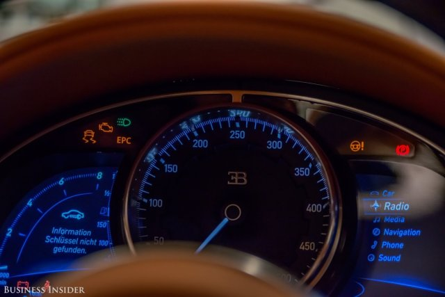 the-chirons-gauge-cluster-features-a-large-center-analog-speedometer-flanked-by-a-pair-of-digital-read-outs-the-speedometer-tops-out-at-310-mph-and-is-designed-to-mimic-the-look-of-a-swiss-watch