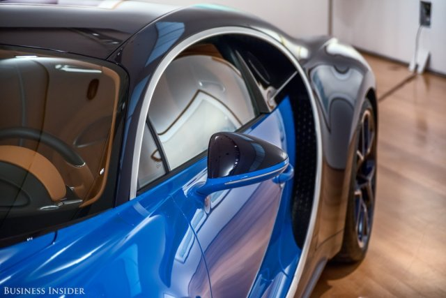 the-exposed-engine-helps-dissipate-the-incredible-amount-of-heat-generated-while-producing-1500-horsepower-in-total-the-chiron-is-equipped-with-a-whopping-10-radiators