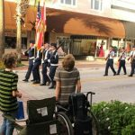 Wheelchair-Bound Teen Stands for the American Flag