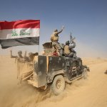 Mosul completely surrounded by Iraqi-led troops, paramilitary forces say