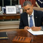 Obama: Busy With His Pen to the End