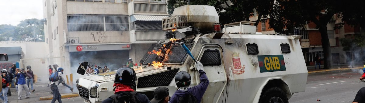 Armored Personnel Carrier Caught On Video Running Over Gaggle Of Venezuelans [VIDEO]