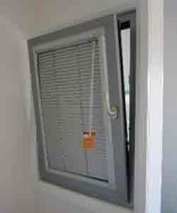 Tilt snd turn double glazed window with internal venetian blind.