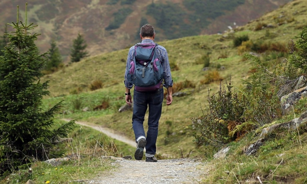 A man performing liss cardio by hiking