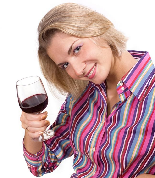 A woman drinks wine.