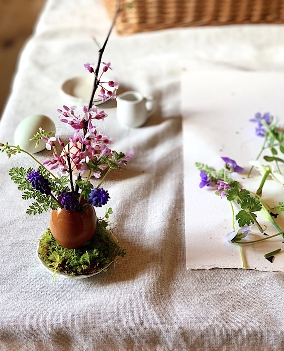 eggshell vase with wildflower bouquet