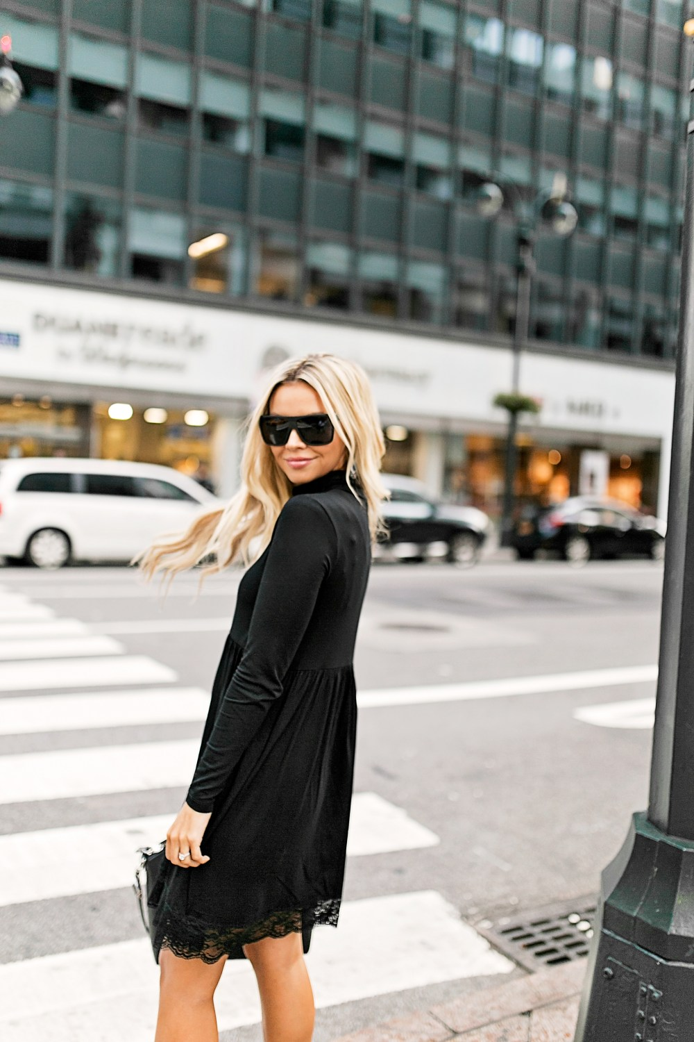 My New York City look in this gorgeous black dress with lace detail and statement booties!