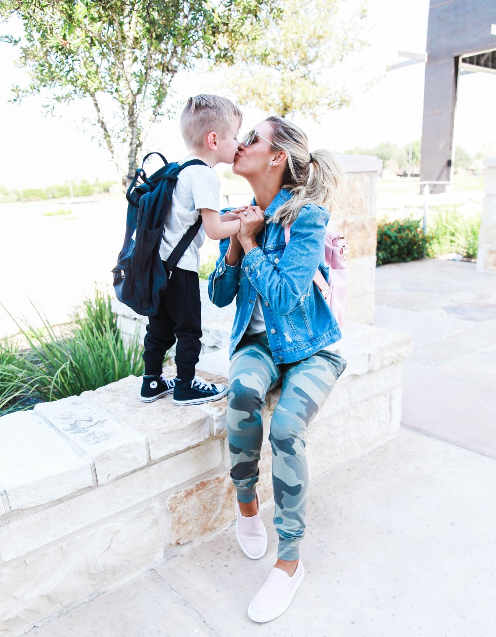 A simple but stylish mom outfit, perfect for running errands! Camo pants and graphic tee with jean jacket! Boy's jogger pants are the it thing in kid's fashion!