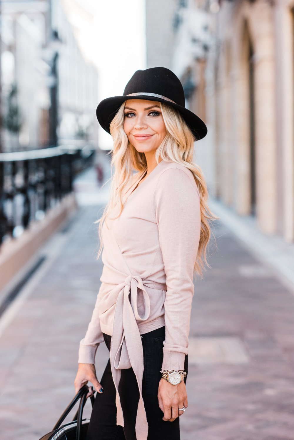 This pink wrap sweater is to die for! It is perfect for spanning multiple seasons and it is SO soft! This pink color and the bow details make it very feminine! This also comes in a Heather Grey color! I am also in love with this black wool floppy hat!