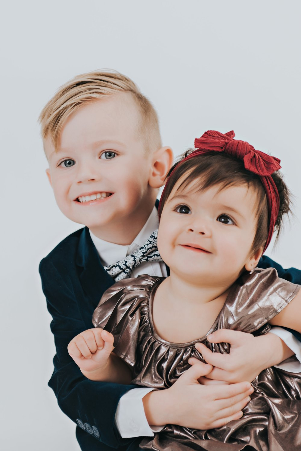 All the heart eyes for these two! This family photo session had to include a sibling photo as well! Tatum's pleated dress is too cute! #familyphotos #girlfashion #boysfashion #siblingphoto #specialoccasion