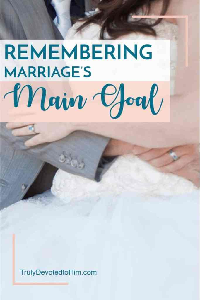Bride & Groom hugging on their wedding day but after the honeymoon marriage can be hard remembering the main goal of marriage helps us stay committed