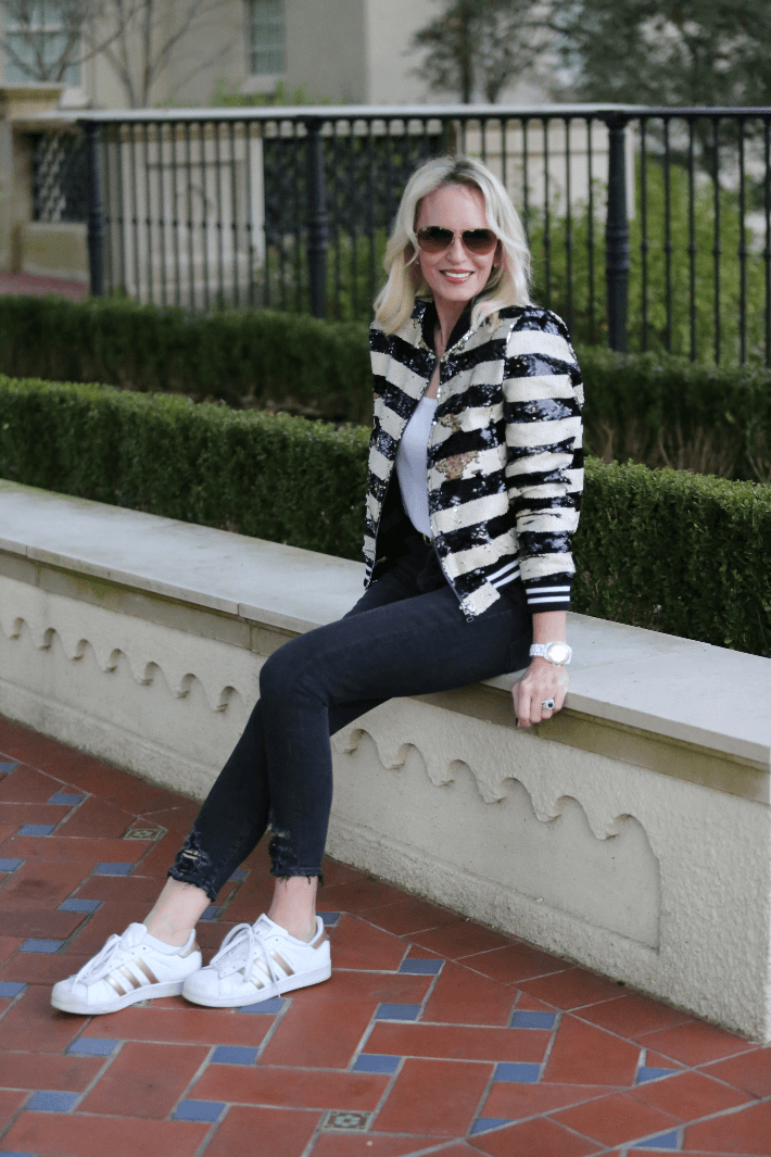 Dallas style blogger Megan Saustad of 'Truly Megan' wearing sequin bomber jacket and Agolde sophie cropped jeans.