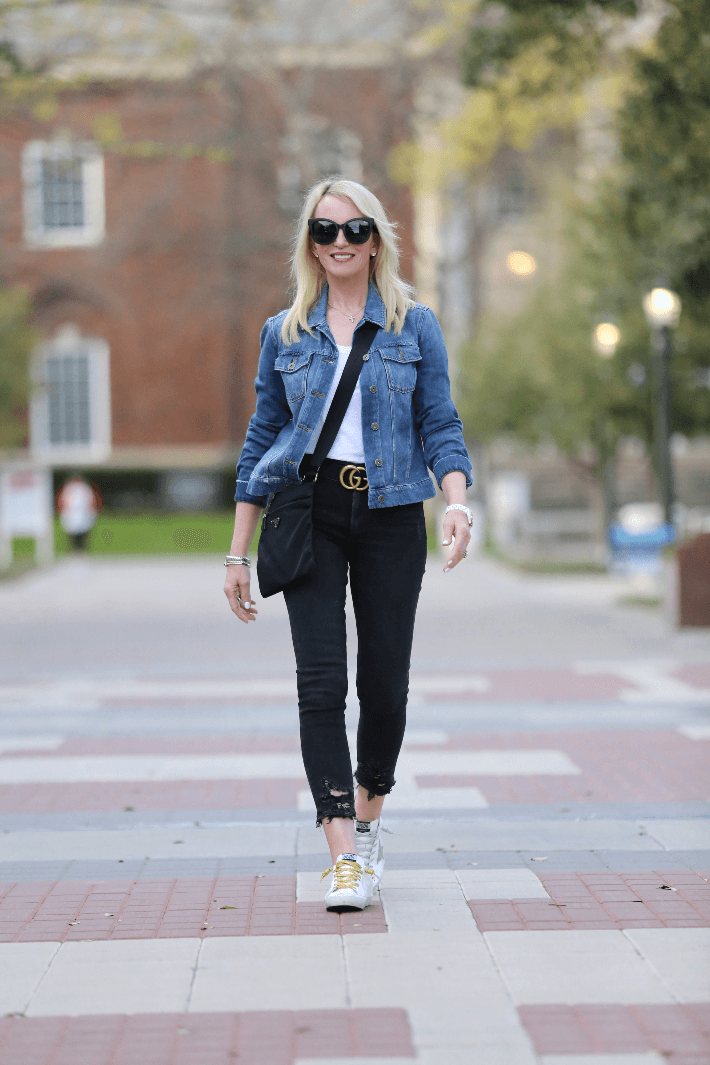 Dallas style blogger Megan Saustad wearing Golden Goose sneakers, Prada crossbody and Gucci belt.