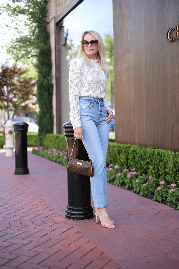 Dallas fashion blogger Megan Saustad wearing white lace blouse by WAYF, Frame jeans, Schutz Ariella heels and carrying Louis Vuitton Eva clutch.