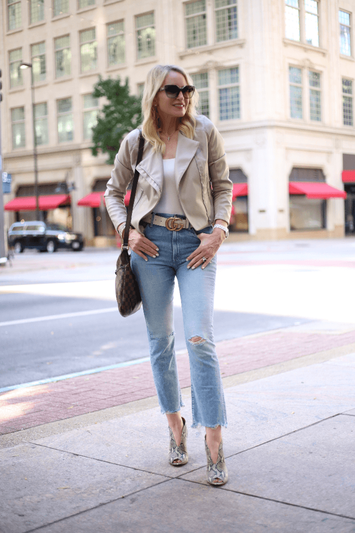 Fashion blogger Truly Megan wearing BlankNYC faux leather moto jacket, Gucci belt and snake print booties by Rowen.