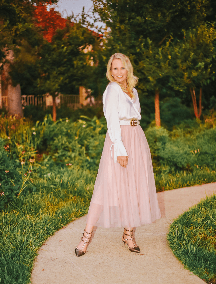 Fashion blogger Megan Saustad wearing Chicwish pink tulle skirt, ivory silk wrap blouse, Gucci Belt and gold Valentino Rockstud ankle strap pumps.
