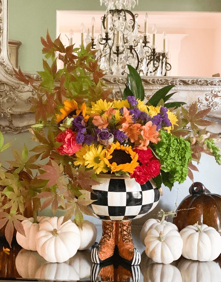 Mackenzie Childs Courtly Check Cauldron filled with fresh autumn flowers.