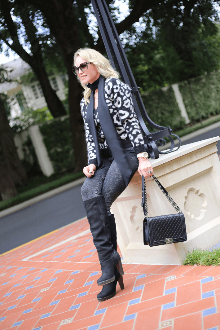 Dallas fashion blogger Truly Megan wearing W by Worth leopard sweater, Frame jeans, black boots and carrying Chanel Boy Bag.
