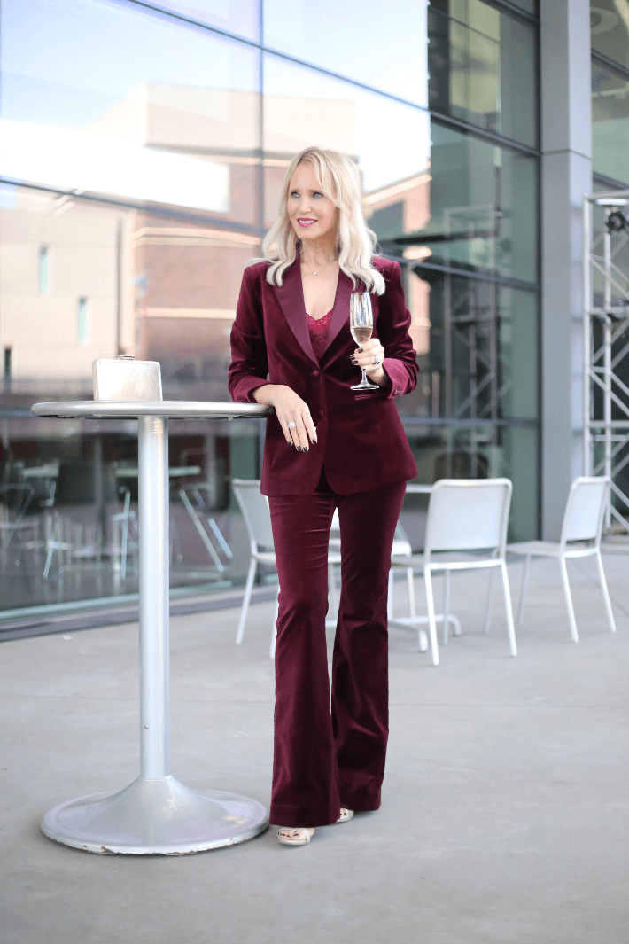 Style blogger wearing W by Worth burgundy velvet pant suit.