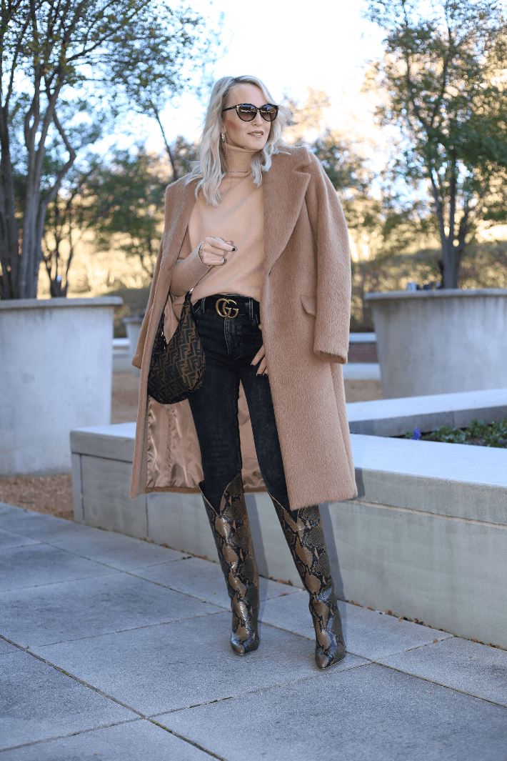 Dallas fashion blogger Megan Saustad wearing camel sweater and coat and Gucci belt. She is carrying a Fendi Zucca hobo bag and wearing Paris, Texas python boots.