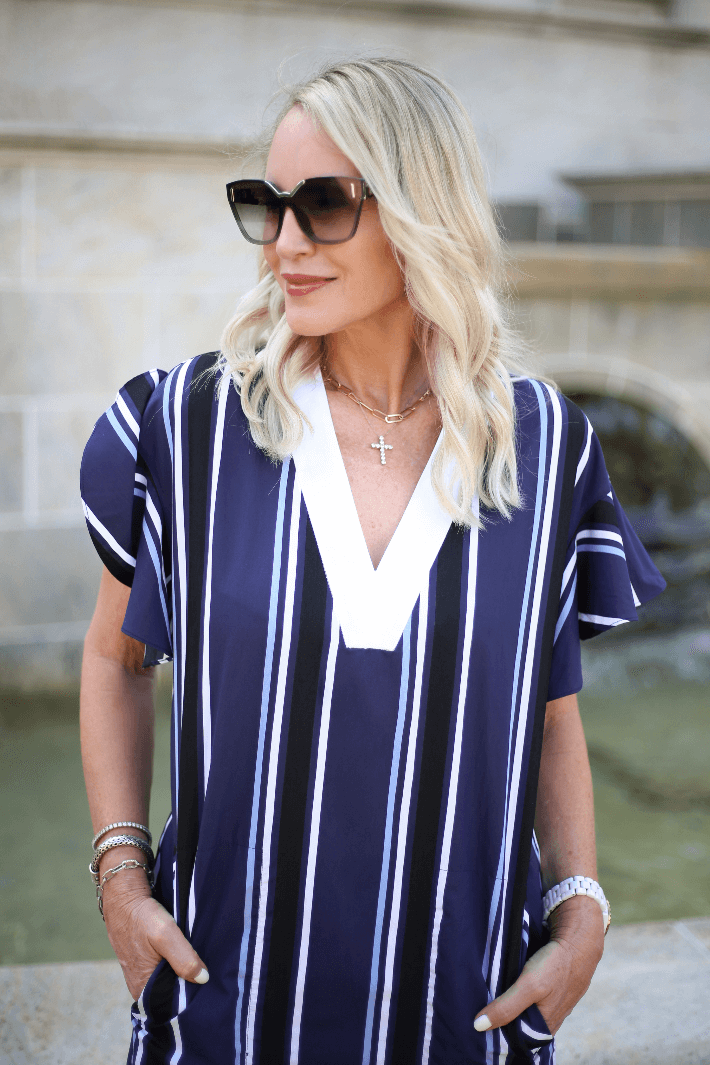 Dallas fashion blogger Megan Saustad of Truly Megan wearing Pearl by Lela Rose Multi Stripe Flutter Sleeve Dress from the Spring 2020 Collection.