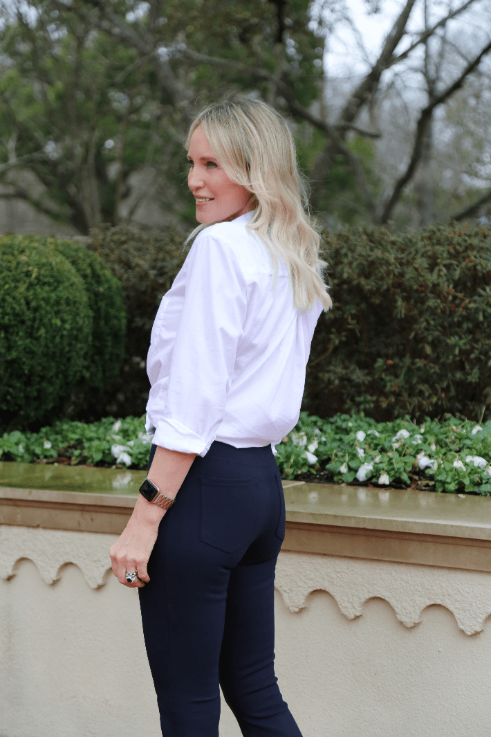 Dallas blogger wearing the Spanx Perfect Pant in Classic Navy, Grayson White Cotton Button Down and Golden Goose Deluxe Sneakers.