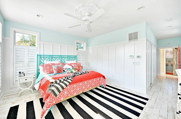 Beach-style-bedroom-with-a-striped-rug-and-fabulous-coral-and-aqua-accents