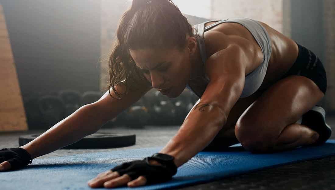 TruSelf Sporting Club woman stretching gym image