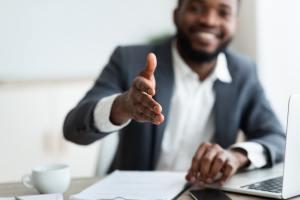 African American entrepreneur extending hand to shake