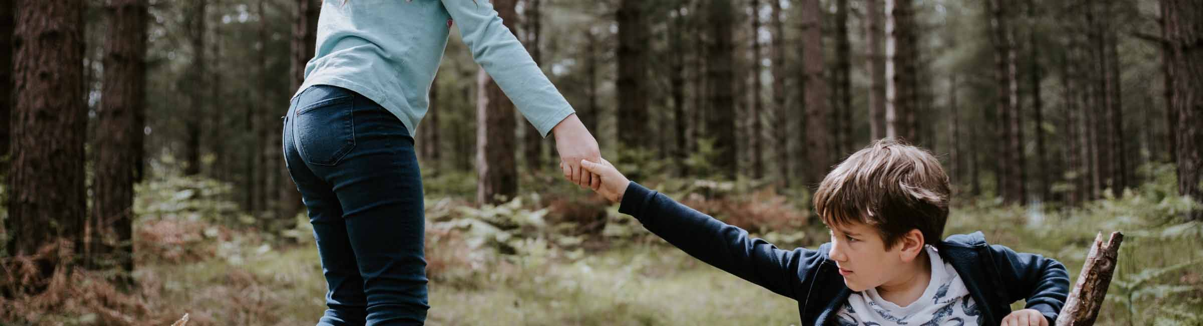 girl and boy helping hand
