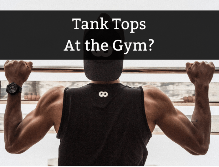 Man in tank top doing pullups at the gym