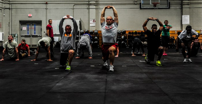 Men and women completing a CrossFit WOD