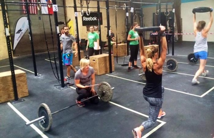 A group working out at a CrossFit box