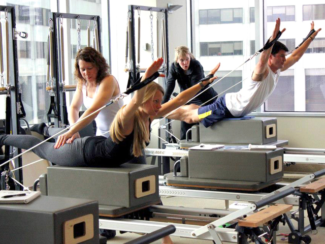 Women in a pilates class with instructor