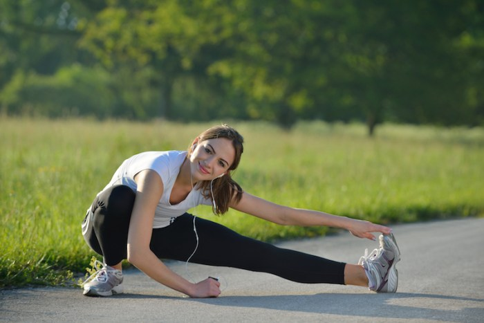 Woman stretching before a run outside