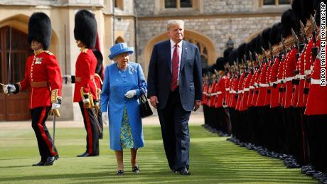 Trump walks with queen