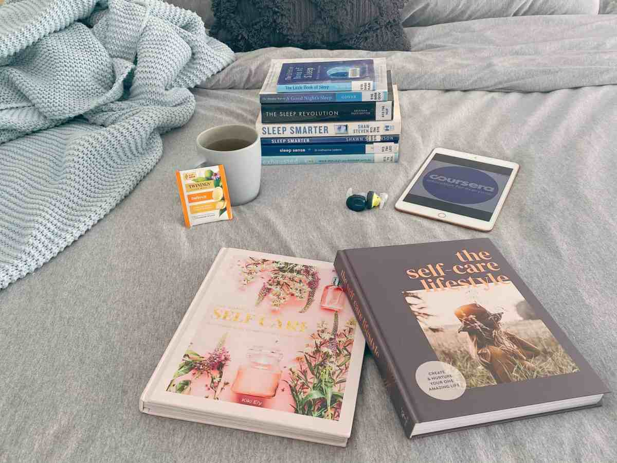 Books sleep, Self-care book, Defence Tea, Coursera on iPad with Headphones and blanket