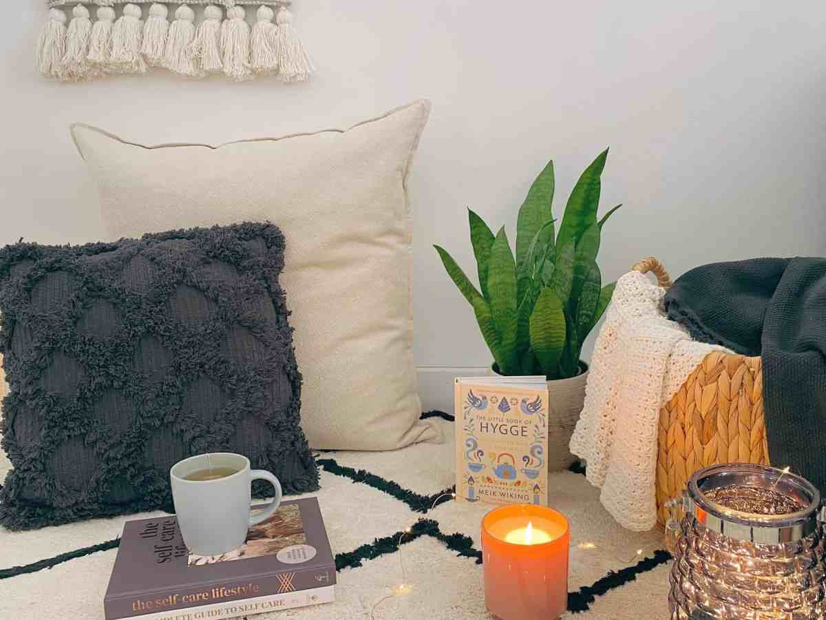 Hygge Self-care, Tea, blankets, pillows, plants, candles, fairy lights, books