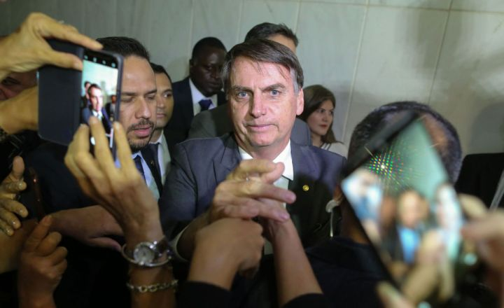 Brazil's President-elect Jair Bolsonaro greets people during his visit to the Superior Court of Labour in Brasilia, on November 13, 2018.