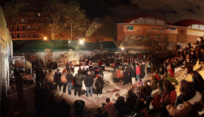 El Campo De Cebada, Madrid hosts a nighttime event with a large audience.